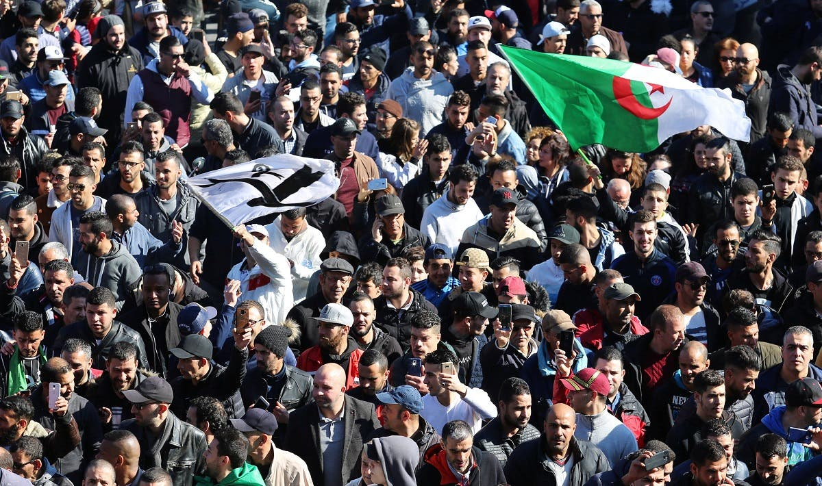 People march to protest against President Abdelaziz Bouteflika's plan to seek a fifth term in Algiers. (Reuters)