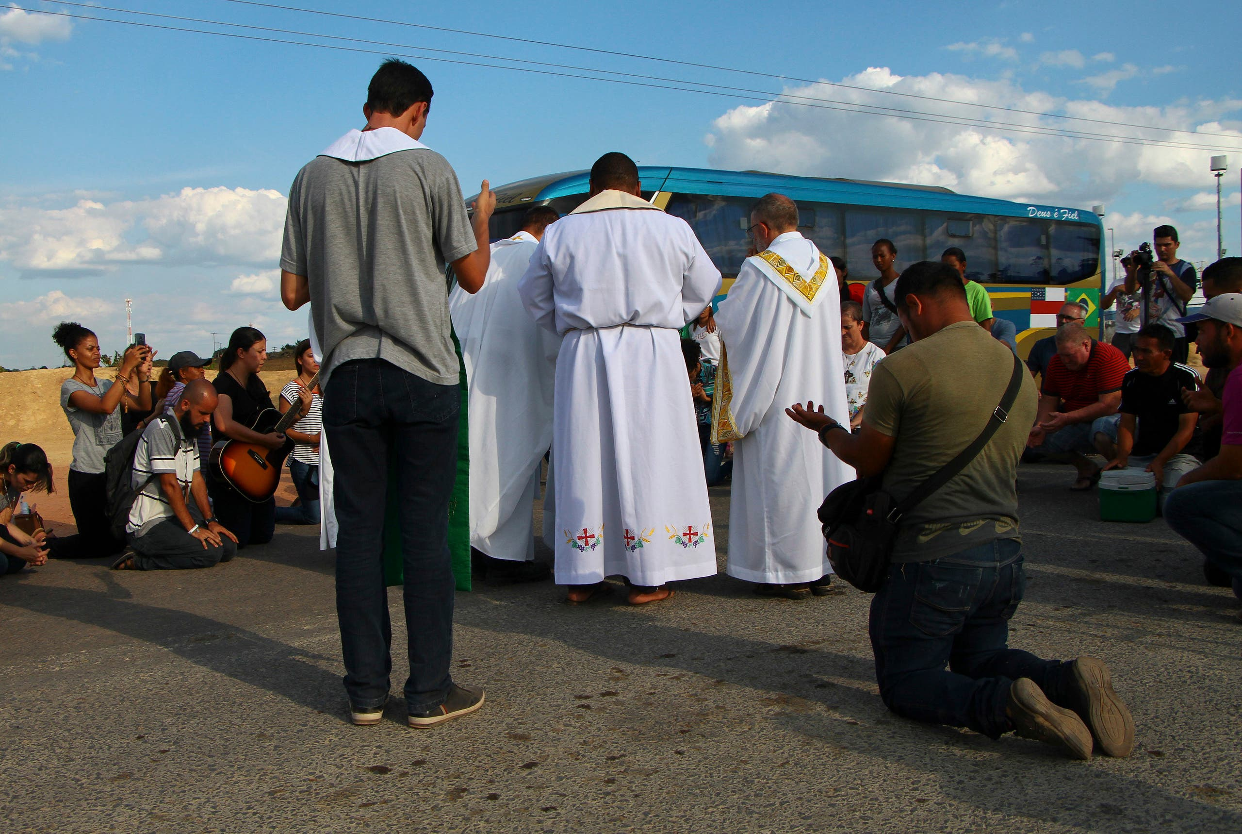 venezuelans hold mass for people killed on brazil border (AP)