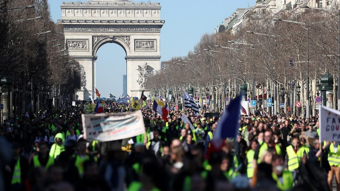 """""""Yellow Vest"""" (Gilet Jaune) protesters gather in front of the Arc de Triomphe during an anti-government demonstration in Paris on February 23, 2019, for the 15th consecutive Saturday. (AFP)"""