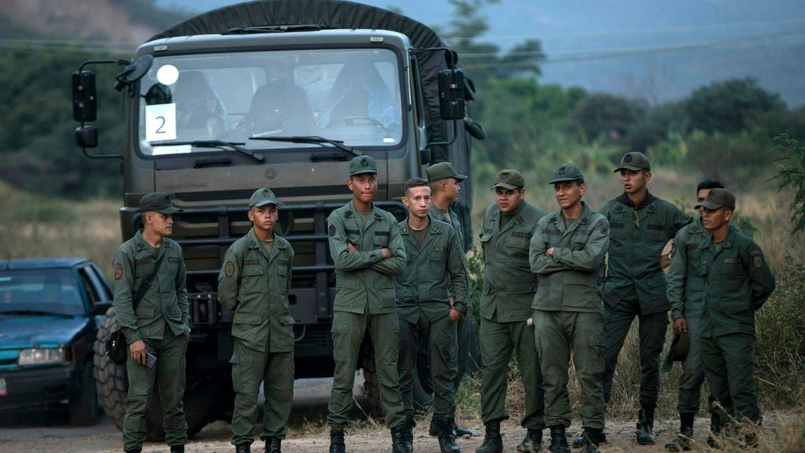 Soldiers stand at the entrance of the Tienditas International bridge that connects Venezuela with Colombia (AP)