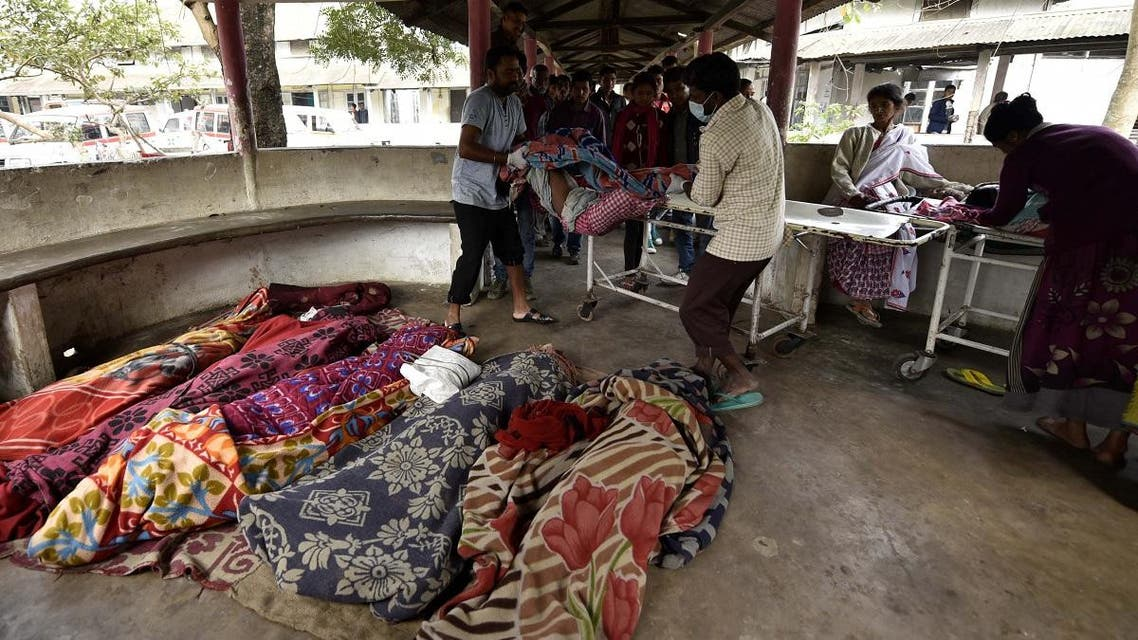 The dead bodies of people killed by drinking toxic bootleg liquor are gathered together at Kushal Konwar Civil Hospital in the northeastern Indian state of Assam on February 23, 2019. (AFP)