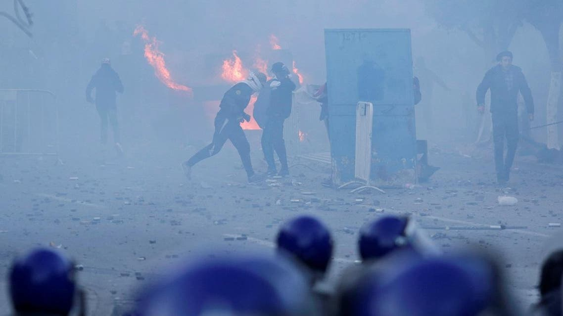 Police use tear gas to disperse crowds as people marched to protest against President Abdelaziz Bouteflika's plan to seek a fifth term in Algiers. (Reuters)