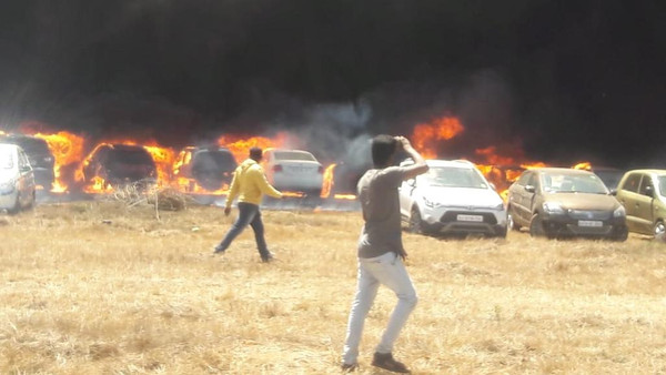 Fire at government-run airshow in India destroys hundreds of cars