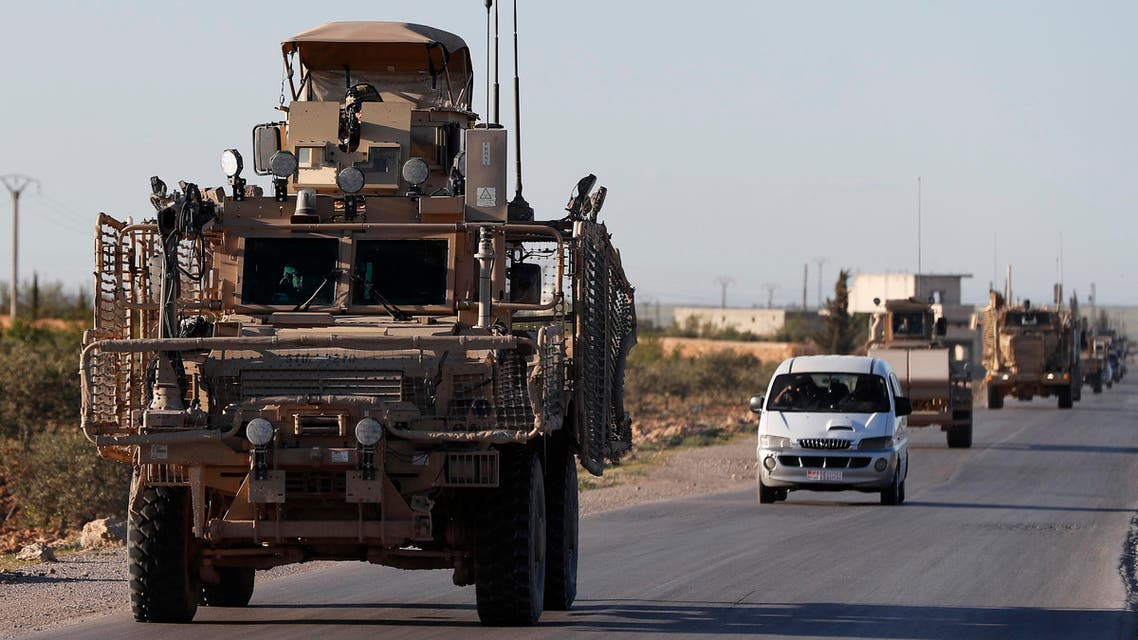 In this Saturday, March 31, 2018 file photo, a convoy of U.S. troops drive along a road leading to the front line with Turkish-backed fighters, in Manbij, north Syria. An American military official said Friday, Jan. 11, 2019 that the U.S.-led military coalition has begun the process of withdrawing troops from Syria. (AP)