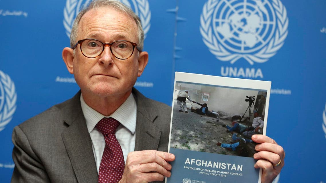 Richard Bennett, United Nations Assistance Mission in Afghanistan Human Rights Director, holds a copy of the UN 2018 Annual Report on the Protection of Civilians in Armed Conflict in Afghanistan. (AP)