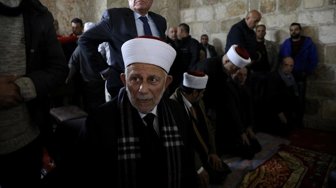Chairman of the Waqf Council, Abdel-Azeem Salhab, attends Friday prayers together with other Palestinian Muslims inside the Golden Gate near Al-Aqsa Mosque in Jerusalem's Old City. (Reuters)