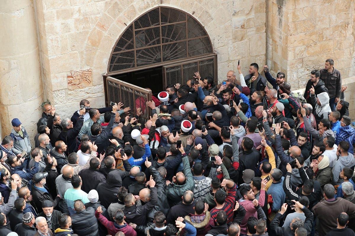 Palestinian Muslims enter the Golden Gate near Al-Aqsa mosque in Jerusalem's Old City. (Reuters)