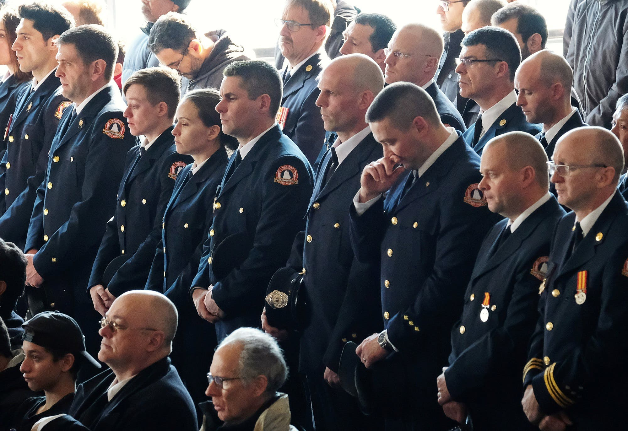 Halifax firefighters listen during the funeral service for a Syrian refugee family who lost seven children in a fire. (Reuters)