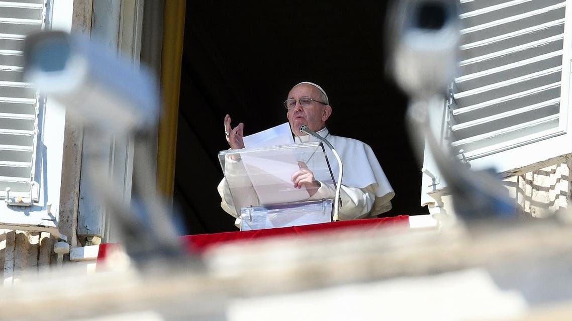 Pope Francis delivers his message from the window of the Apostolic palace as he arrives for the weekly Angelus prayer. (AFP)