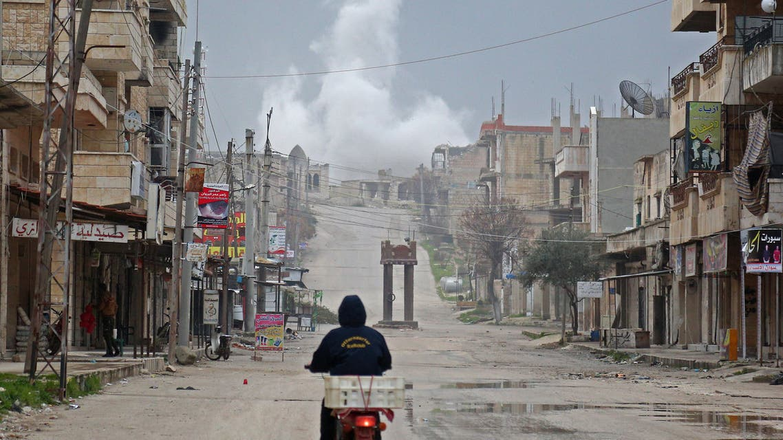 A man rides a scooter on a street during reported air strikes in the town of Khan Sheikhun in the southern countryside of the rebel-held Idlib province, on February 22, 2019.