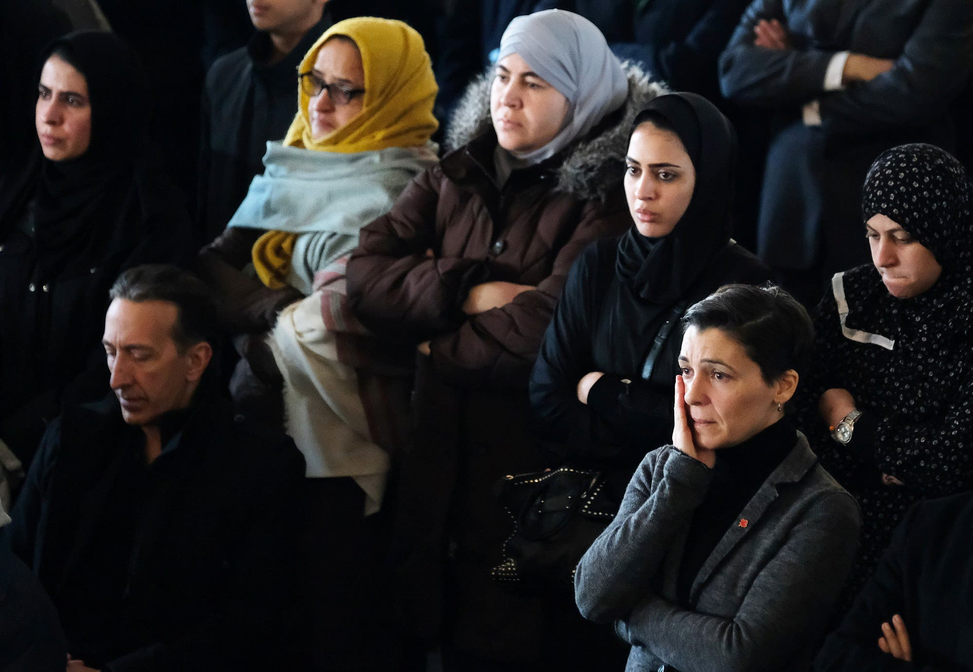 Mourners listen during the funeral service for a Syrian refugee family who lost seven children in a fire. (Reuters)