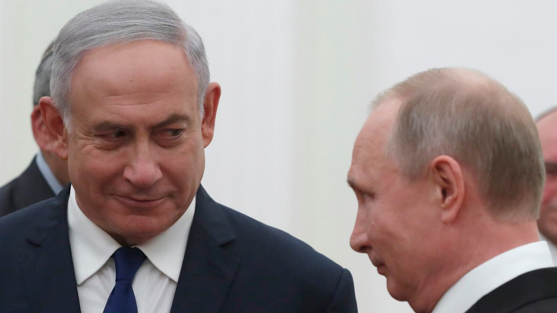 Russian President Vladimir Putin (R) meets with Israeli Prime Minister Benjamin Netanyahu at the Kremlin in Moscow on May 9, 2018.