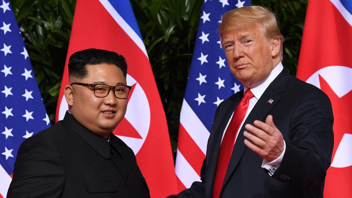 (FILES) This file photo taken on June 12, 2018 shows US President Donald Trump (R) gesturing as he meets with North Korea's leader Kim Jong Un (L) at the start of their historic US-North Korea summit, at the Capella Hotel on Sentosa island in Singapore. US President Donald Trump and North Korean leader Kim Jong Un meet in Hanoi on February 27-28, 2019, faced with putting meat on the bones of the vaguely worded declaration that emerged from their historic first summit in Singapore.