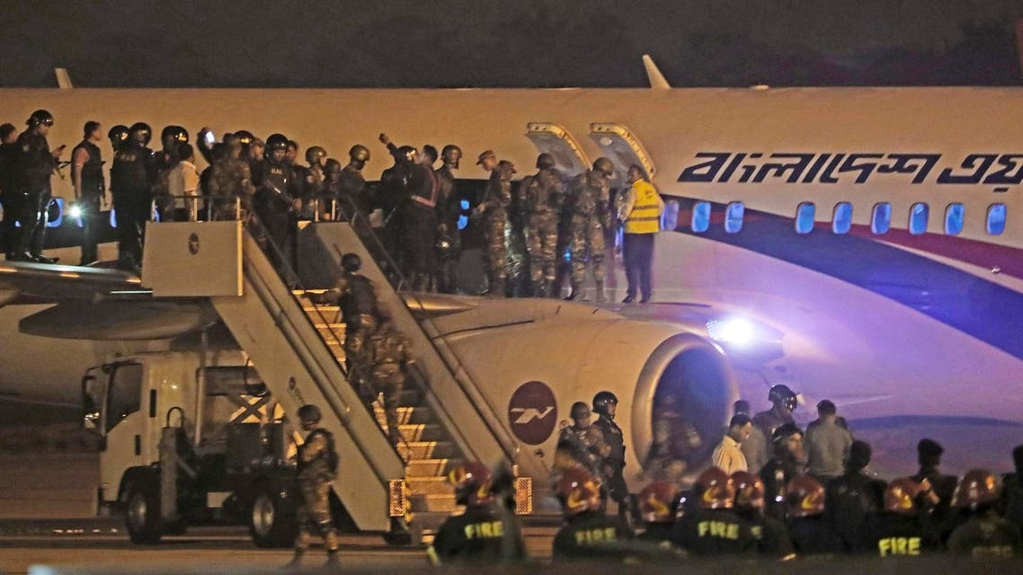Bangladeshi security personnel stand guard near a Bangladesh Biman plane following an emergency landing after a man apparently attempted to hijack the aircraft. (AFP)