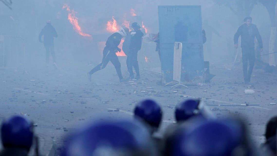 Police use tear gas to disperse crowds as people march to protest against President Abdelaziz Bouteflika's plan to seek a fifth term in Algiers, on February 22, 2019. (Reuters)