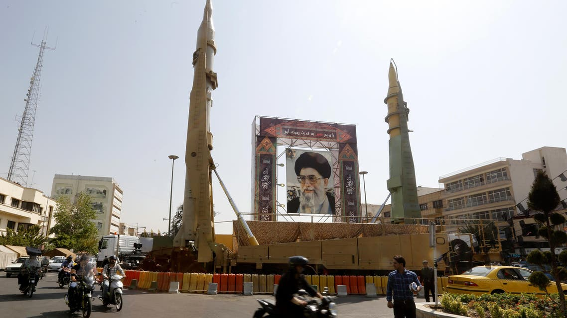 Iranians walk past Sejjil (L) and Qadr-H medium range ballistic missiles displayed next to a portrait of Iranian Supreme Leader Ayatollah Ali Khamenei on the occasion of the annual defence week which marks the anniversary of the 1980s Iran-Iraq war, on September 25, 2017, on Baharestan square in Tehran.