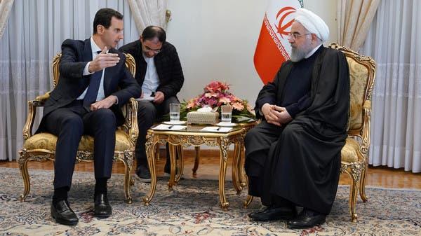 """""""العلم السوري"""" يغيب عن لقاءات الأسد في إيران"""