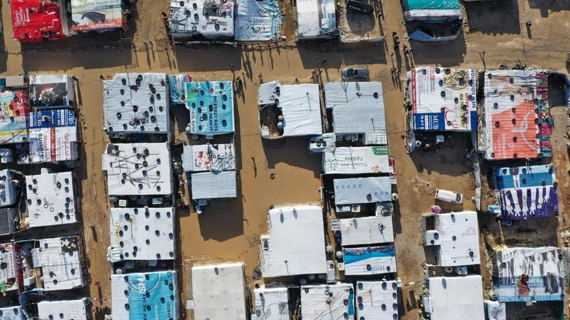 An aerial view shows an informal tent settlement housing Syrian refugees in the Bekaa Valley, Lebanon. (File photo: AFP)