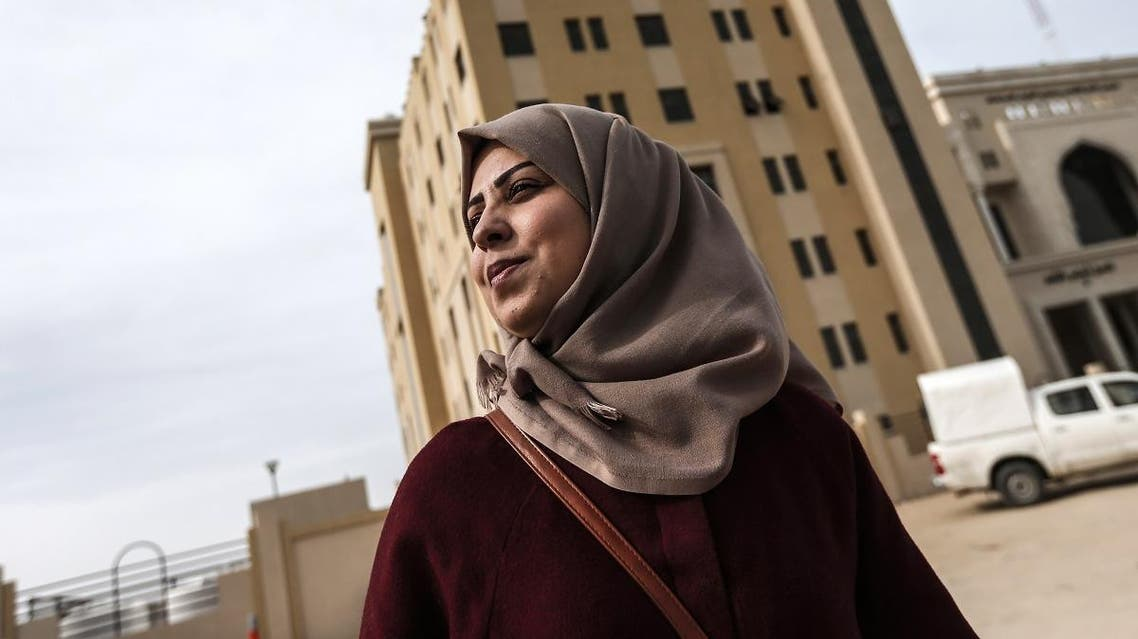Palestinian journalist Hajar Harb stands in front of the courts complex in Gaza City, on February 26, 2019. (AFP)