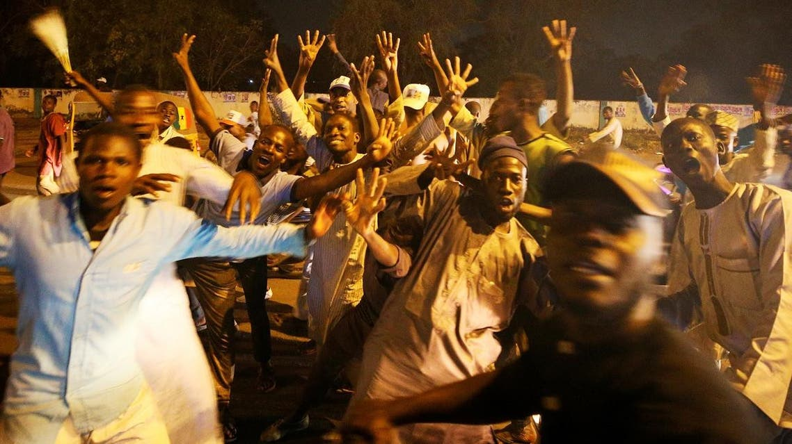 Supporters of All Progressives Congress (APC) celebrate after initial results were released by the Independent National Electoral Commission in Kano, Nigeria, on February 25, 2019. (Reuters)