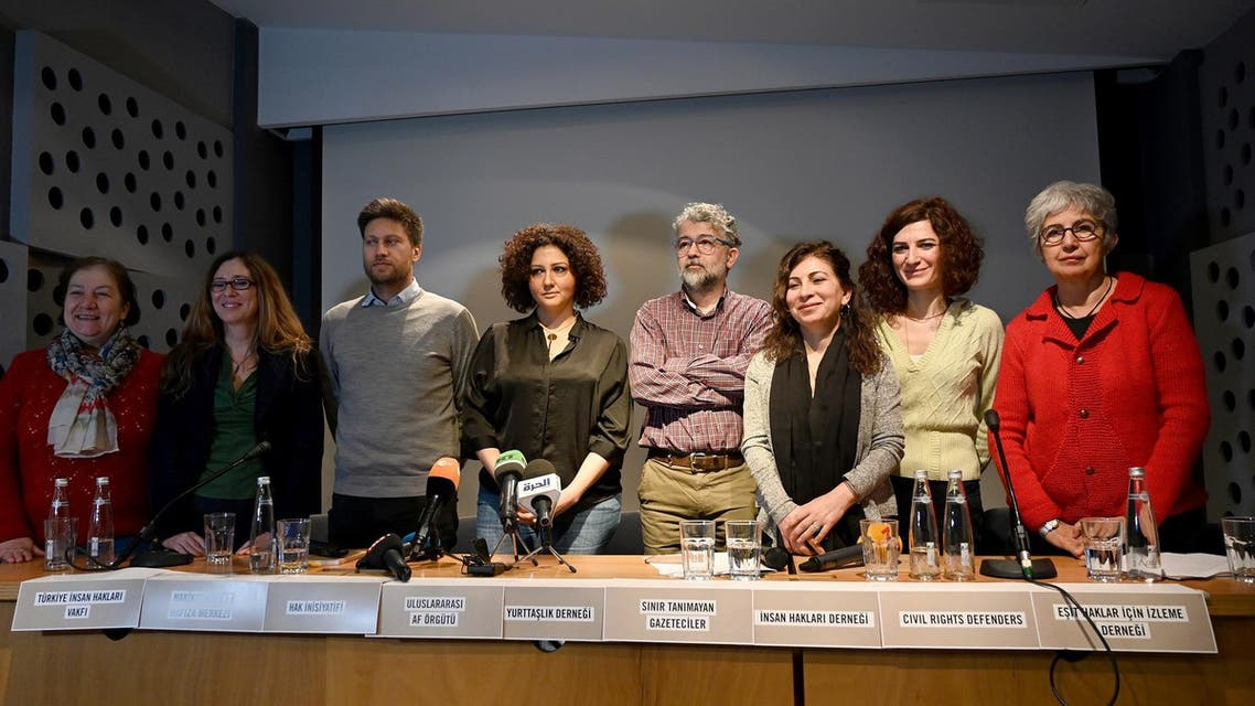 Amnesty International and other NGO's representatives attend a press conference on February 27, 2019 to condemn attacks on civil society groups in Turkey. (AFP)