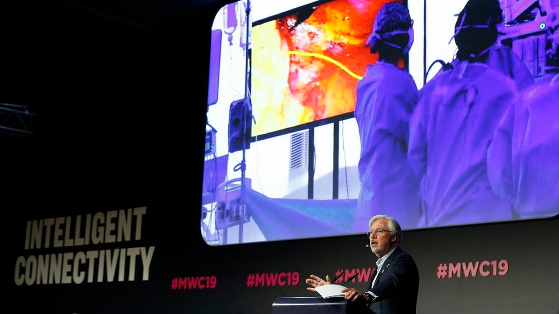 Doctor Antonio Lacy of Hospital Clinic de Barcelona delivers a speech about the first 5G tele-mentored live surgery at the Mobile World Congress (MWC) in Barcelona on February 27, 2019. (AFP)