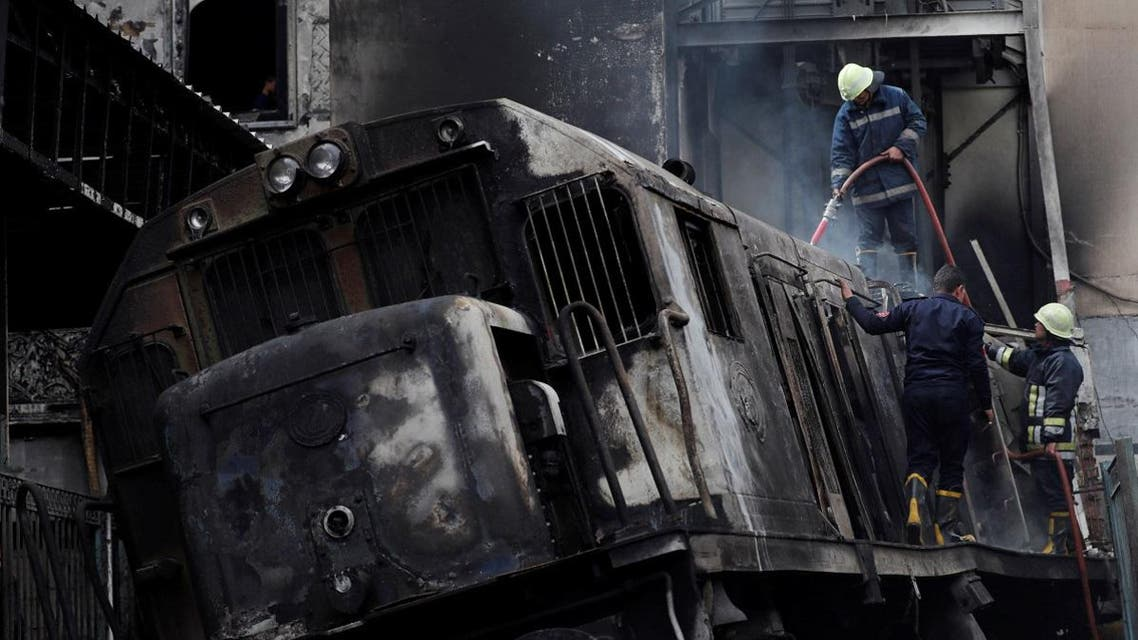 Rescue workers put out a fire at the main train station in Cairo. (Reuters)