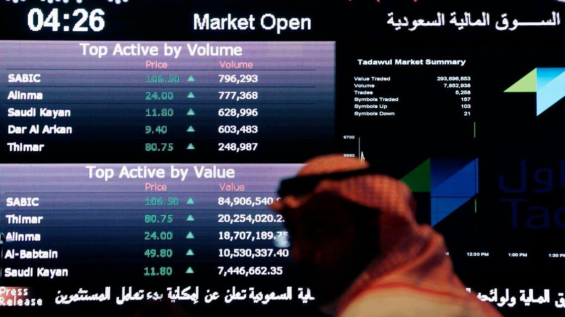 A Saudi man looks at stocks at the Tadawul Saudi Stock Exchange in Riyadh on June 15, 2015. (File photo: AP)