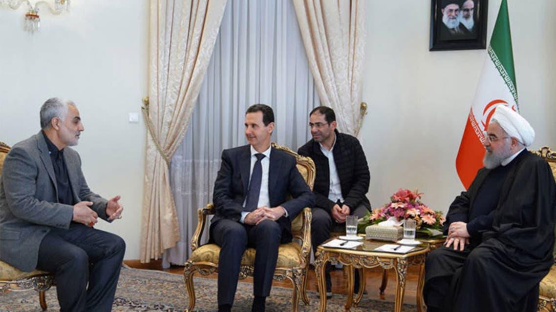 صورة تجمع الأسد بروحاني وقاسم سليماني