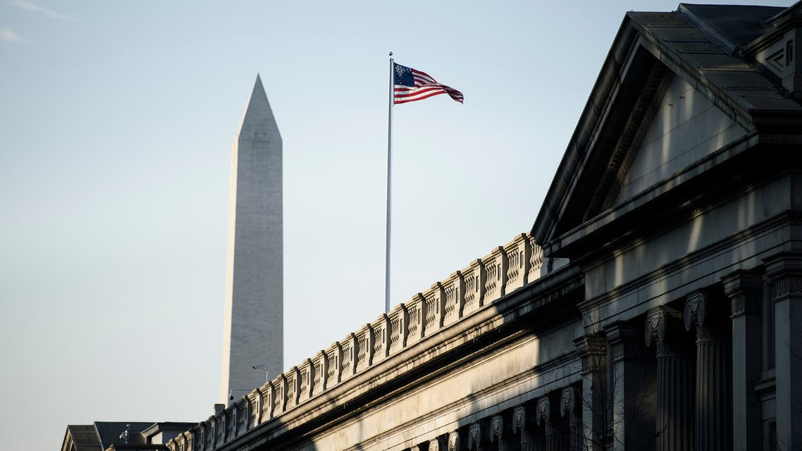 A view of the US Treasury building and the Washington Monument(L) are seen on February 6, 2019 in Washington, DC.