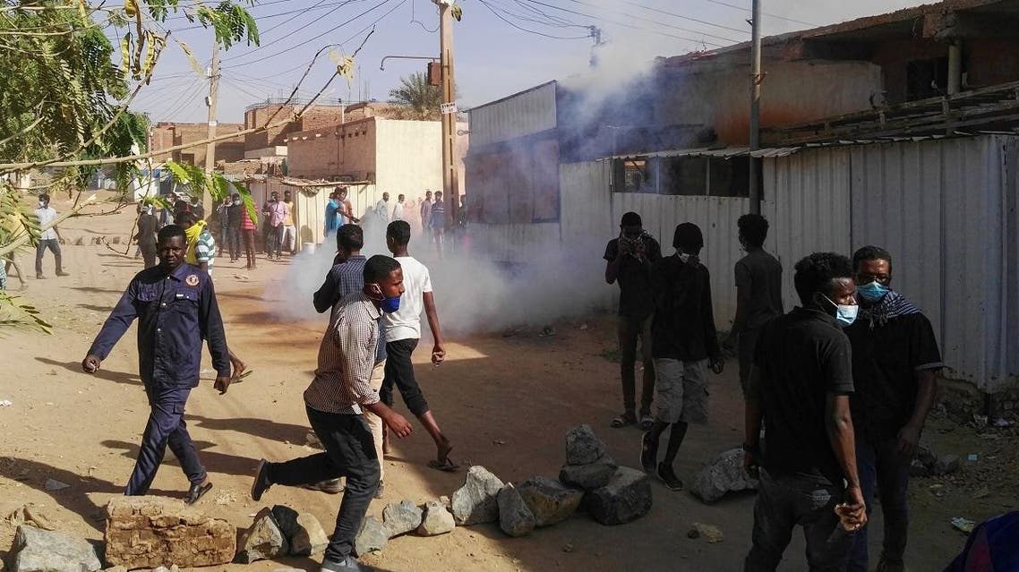Sudanese protesters demonstrate against their government in the capital Khartoum's district of Burri (AFP)