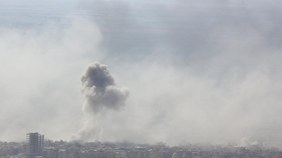 Smoke billows in the town of Douma, the last opposition holdout in Syria's Eastern Ghouta, on April 7, 2018, after Syrian regime troops resumed a military blitz to pressure rebels to withdraw. Backed up by Russia's firepower, Syrian President Bashar al-Assad has ousted his armed opponents from nearly all of Ghouta, their last stronghold on the edge of the capital. The regime has used a combination of a fierce military onslaught and two negotiated withdrawals to empty out 95 percent of the enclave, but rebels are still entrenched in its largest town of Douma.