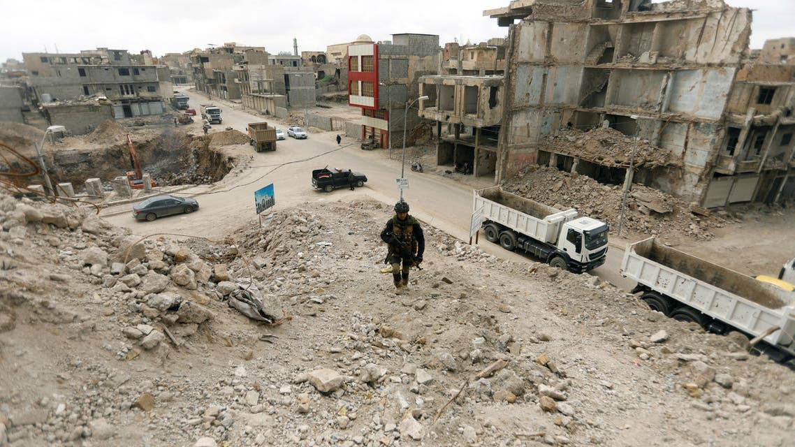 A member of Iraqi security forces passes by destroyed buildings by the war, in the Old City of Mosul, Iraq February 27, 2019. REUTERS/Khalid al-Mousily