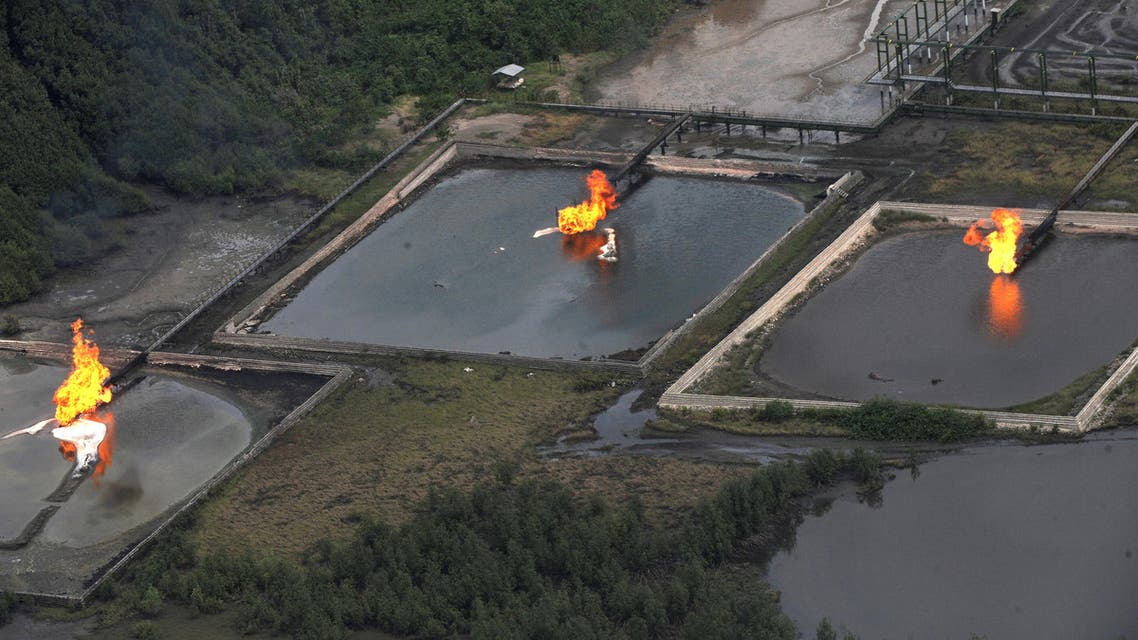 A picture taken on March 22, 2013 shows gas flare at Shell Cawtharine Channel, Nembe Creek in the Niger Delta. Shell Petroleum Development Company of Nigeria (SPDC) on April 2, 2013 said it would temporarily shut down production the Nembe Creek Truck Line (NCTL) to remove a number of bunkering points on pipelines vandalised by oil thieves in the region. AFP PHOTO / PIUS UTOMI EKPEI