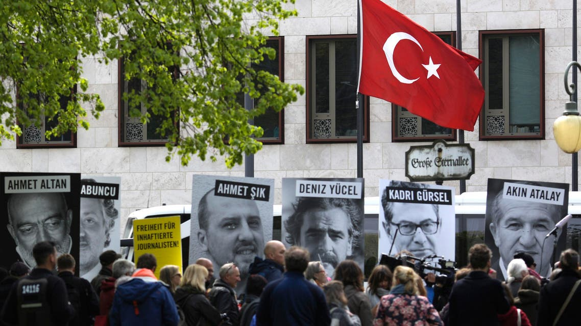 Marking the World Press Freedom Day, activists with Reporters Without Borders hold posters with portraits of journalists detained in Turkey, to protest against the situation for media in the country, in front of the Turkish embassy in Berlin (AP)
