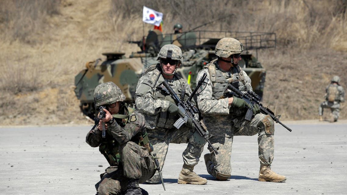U.S. Army soldiers from the 25th Infantry Division's 2nd Stryker Brigade Combat Team and a South Korean soldiers take their position during a demonstration of the combined arms live-fire exercise as a part of the annual joint military exercise Foal Eagle between South Korea and the United States (AP)