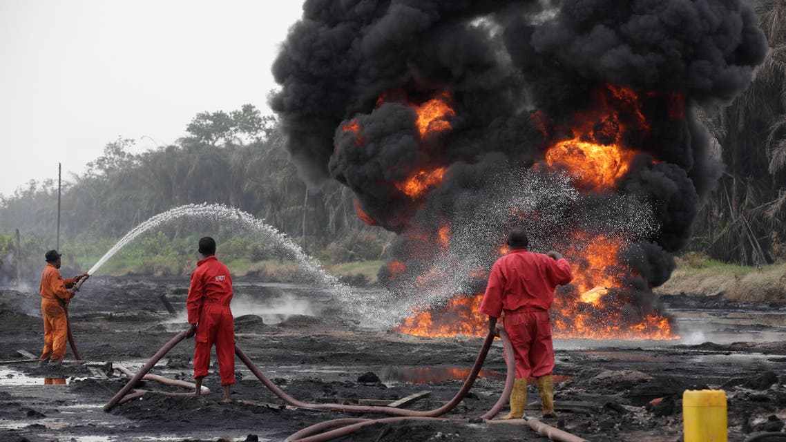 Fire fighters try to contain flames from a burning oil pipeline in Ijeododo outskirt of Lagos, Nigeria (AP)