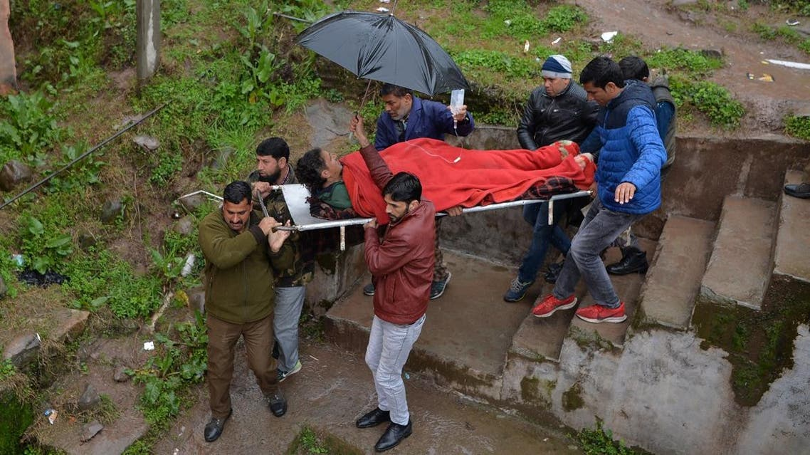 An injured man is carried on a stretcher at a hospital in the Indian Kashmir frontier town of Mendhar on March 2, 2019, after being wounded in his home when it was struck by a mortar shell that his family said was fired by Pakistan troops along the Line of Control (LoC) that divides Kashmir between India and Pakistan. (AFP)