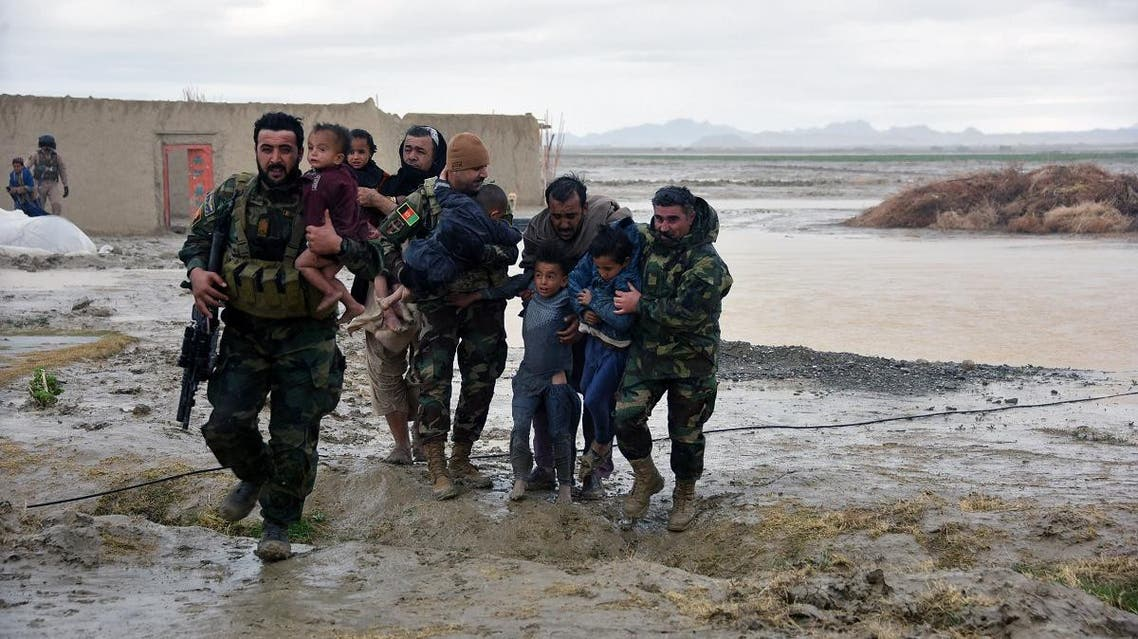 Afghan Security forces carry children after flood affected their homes in Arghandab district of Kandahar province. (AFP)