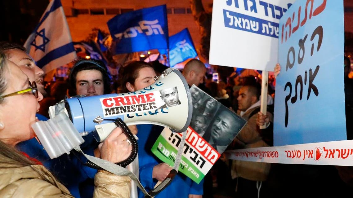 Left-wing demonstrator carry placards and chant slogans during a protest against Israeli Prime minister Benjamin Netanyahu in downtown Tel Aviv on March 2, 2019. (AFP)