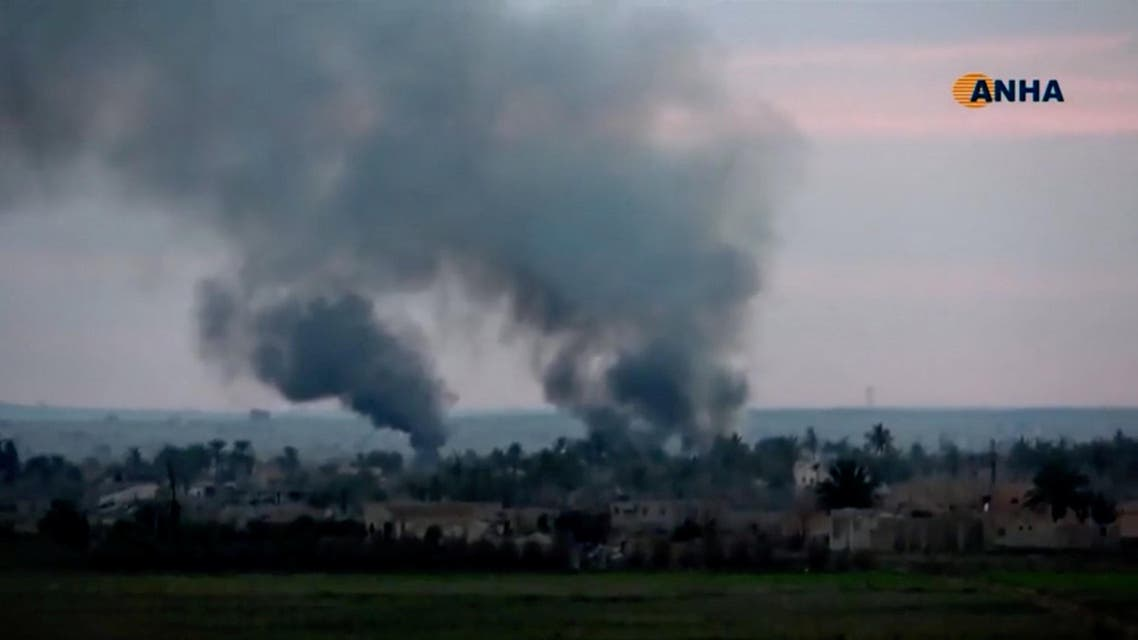 Smoke rises from a village near Baghouz, Syria, in this still image taken from a video by ANHA. (Reuters)