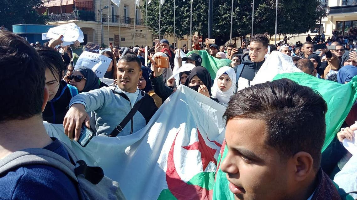 Algerians march with a national flag during a protest rally against ailing President's bid for a fifth term in power, in the northeastern city of Annaba on March 3, 2019.