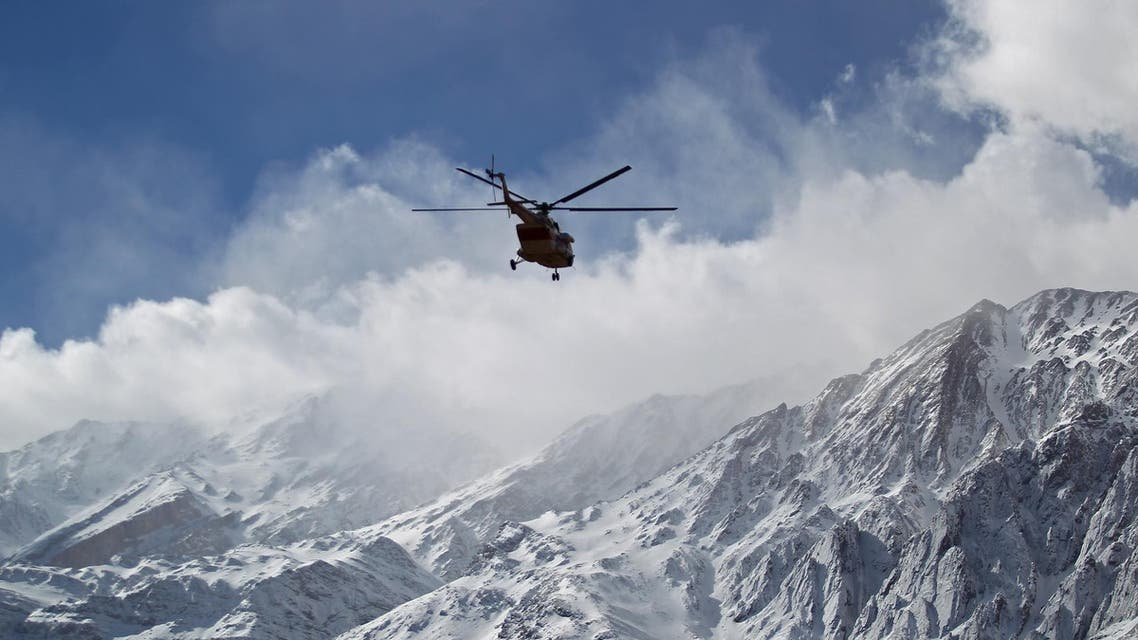 Emergency and rescue helicopter searches for another plane that crashed in a mountainous area of central Iran on February 19, 2018. (AFP)