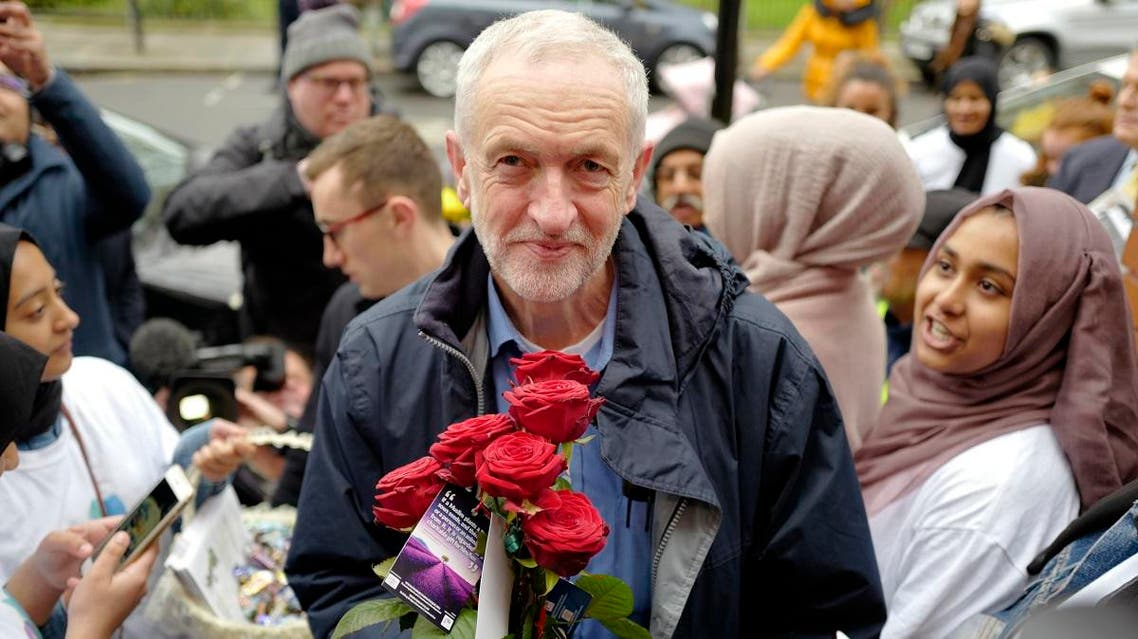 Opposition Labor Party leader Jeremy Corbyn holds a rose as he arrives at Finsbury Park mosque March 3, 2019. (AFP)