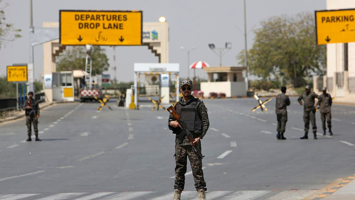 Pakistani troops stand guard on a blocked road to the Jinnah International Airport in Karachi, Pakistan, Thursday, February 28, 2019.  (AP)