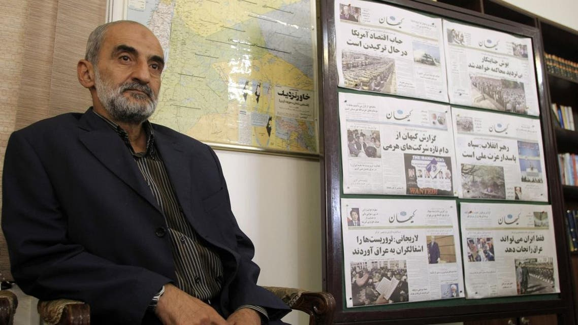 Hossein Shariatmadari, director of the hardline Kayhan (Universe) newspaper group since 1993, sits next issues of the newspaper at his office in Tehran. (File photo: AFP)
