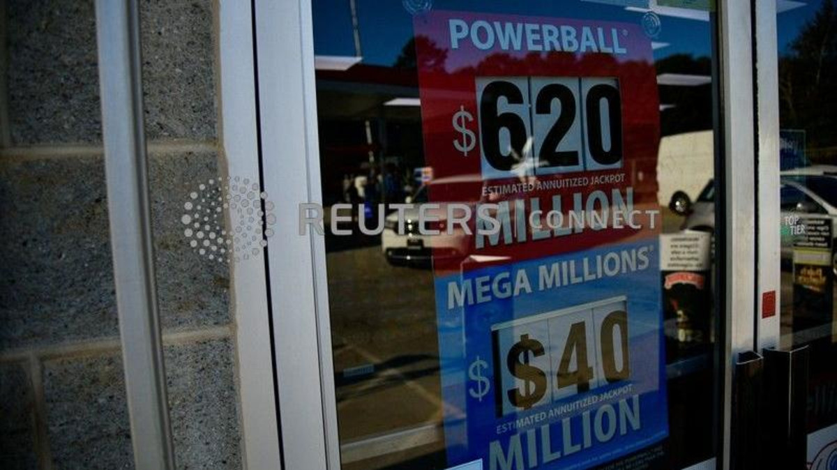 A sign advertising the next Powerball and Mega Millions jackpots at the KC Mart in South Carolina on October 24, 2018. (Reuters)