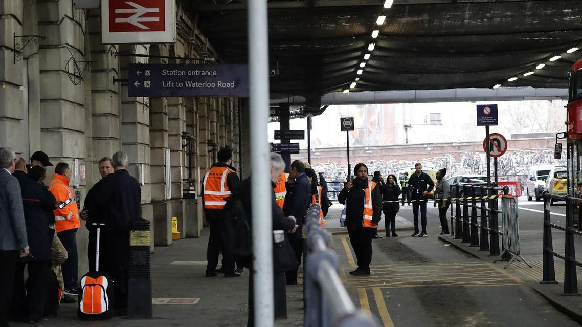 Security personel stand guard outside Waterloo station in central London. (AFP)