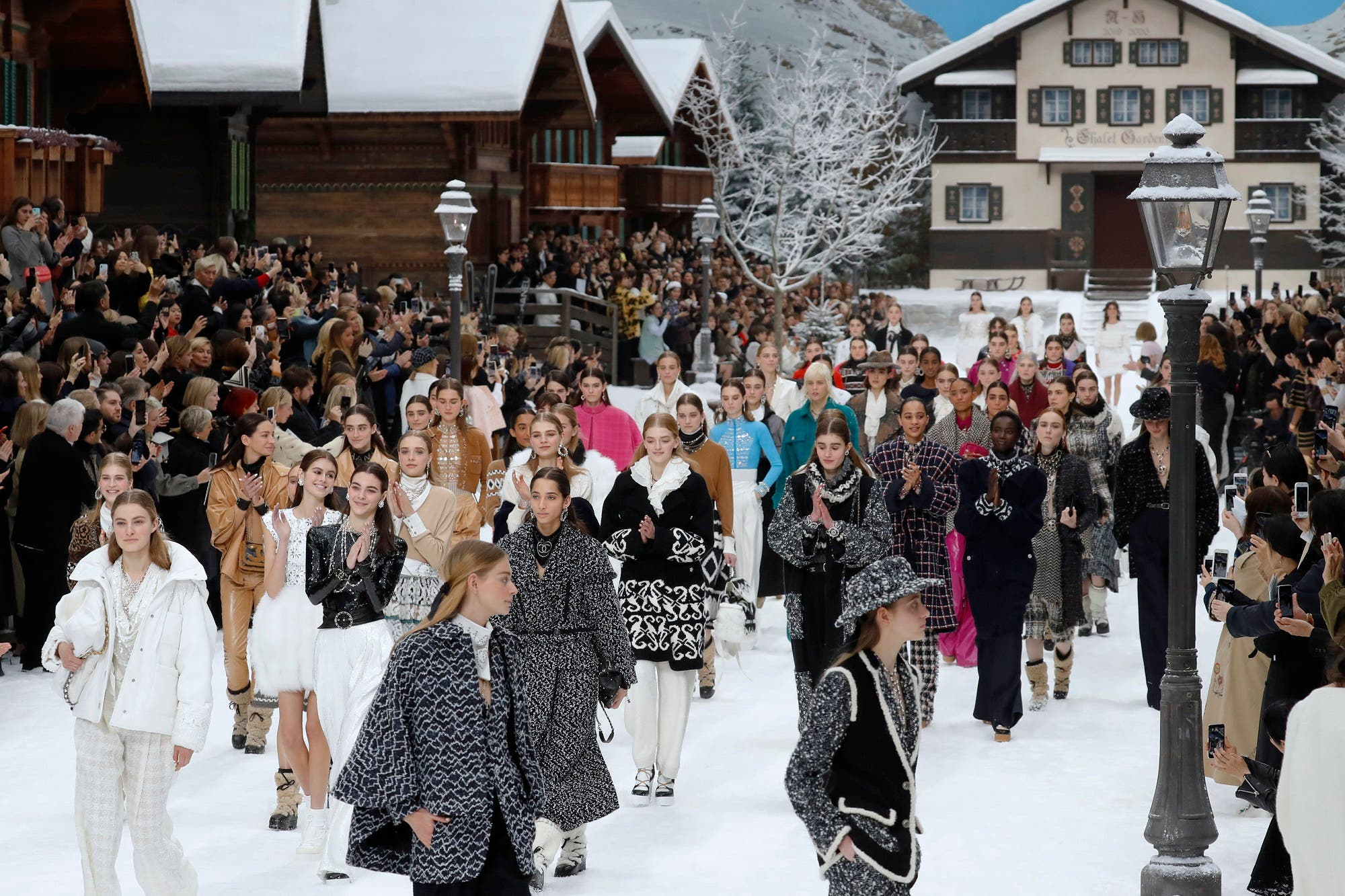 Models applaud in tribute to Chanel's late German fashion designer, Karl Lagerfeld, at the end of the Chanel Women's fashion show at the Grand Palais, turned into a wintry village in Paris, on March 5, 2019. (AFP)