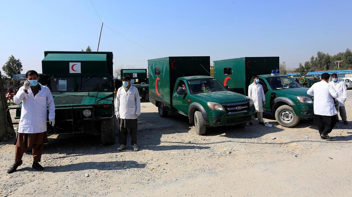 Ambulances are parked while waiting to transfer the wounded near the site of an attack in Jalalabad. (Reuters)